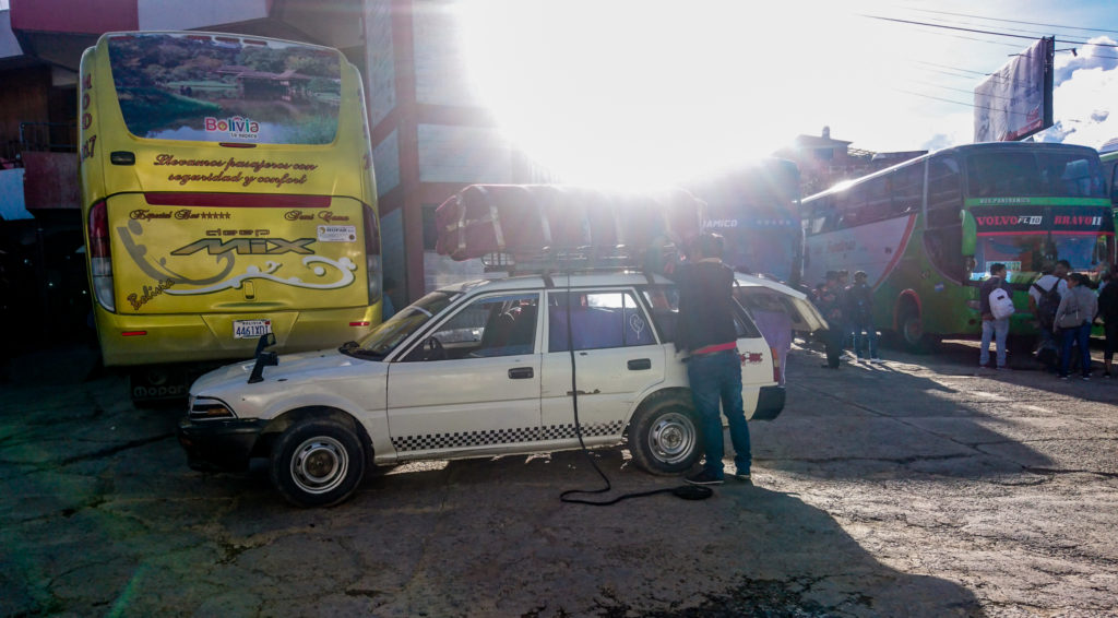 Coffin being loaded onto night bus in Bolivia | How to get to Sucre bus terminal travel guide
