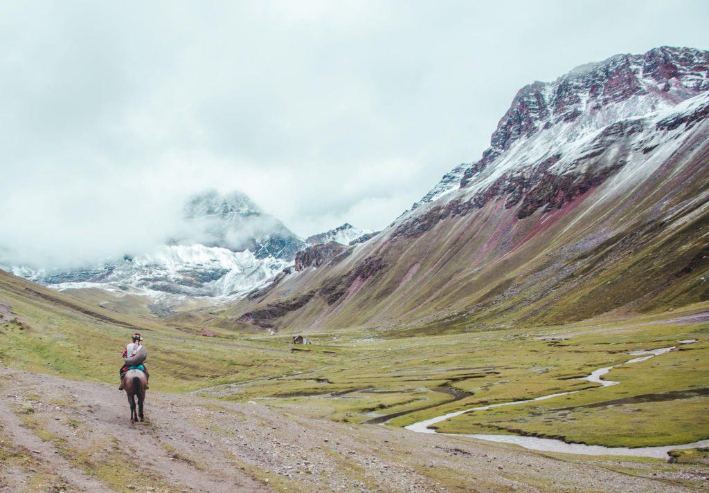 Hiring a horse at Rainbow Mountain Cusco Peru tour